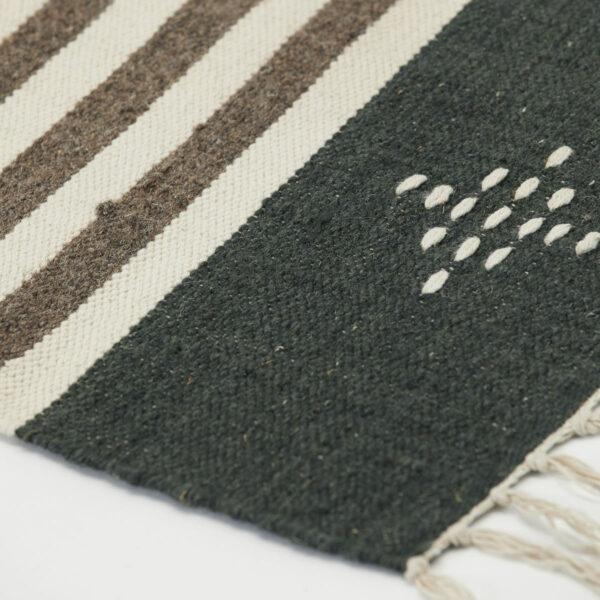 Coto tæppe fra House Doctor i brun med størrelsen 90x200